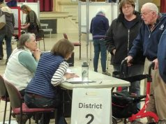 Voters check in at City Hall on Town Meeting Day. Photo by Tom Brown